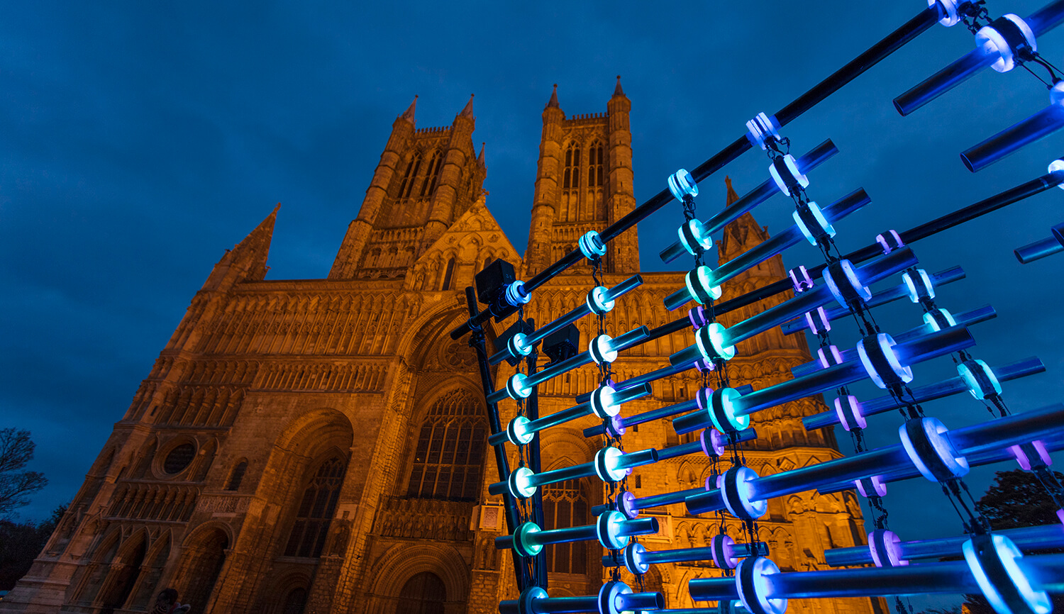 Illumaphonium light installation with blue lights outside Lincoln cathedral