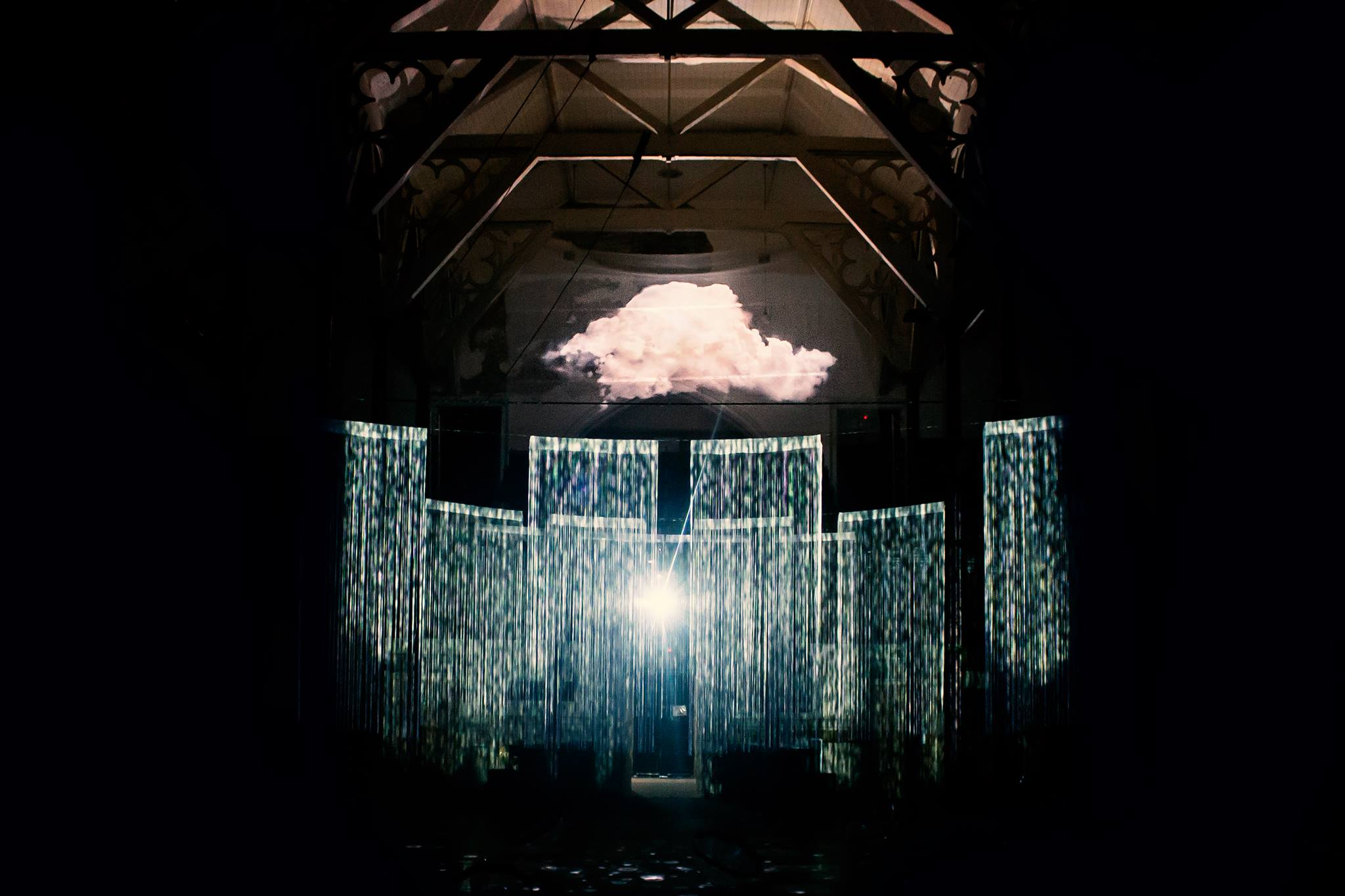 Lighting installation with a cloud and sheets of rain/light