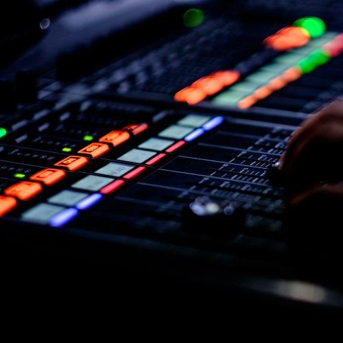 hand on audio mixer
